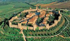 Monteriggioni, Italy was mentioned in by Chaucer in Canterberry Tales. It's wall was built by the Romans and is one of the few hill towns with it's wall still completely intact.