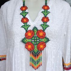 Hand-beaded Huichol necklace from Mexico. http://lasninastextiles.com/product-category/jewellery-3/