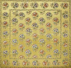A fine Ottoman metal-thread embroidered silk Panel  Turkey, late 18th Century/ early 19th Century rectangular, the yellow silk ground embroidered in polychrome silks and metal thread with a repeat design of floral sprays, the borders with an undulating floral vine, mounted