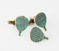 This tie pin and cufflinks set was handmade by me with love using antiqued brass verdigris hot air balloon charms on antiqued brass cufflinks and stainless steel tie tack. They come giftwrapped and ready for your special guy!  DETAILS *Listing is for 1 set of cuff links and 1 tie pin. *Hot air balloons are about .8 or 21mm. *Free gift wrapping included    All Smitten Kitten Jewellery is designed and handmade with love by me. If you are dissatisfied with your new treasure, let me know within…
