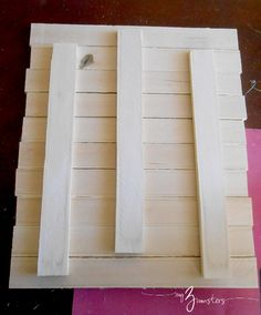 """How to create the """"pallet"""" out of contractor grade wood shims to use as the basis for """"pallet art""""; also advice on using layers of spray paint as the base"""