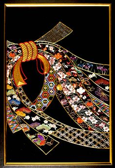 Noshi (ribbons) by Peggy Lipski is an adaptation of a Kurenai-Kai design worked on black shioze with Japanese flat silk and gold threads, using several traditional Japanese embroidery techniques, including couching gold threads, long and short, diagonal single layer and shippos.