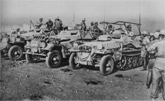 German armored vehicles parked in the North African desert. The first bids for the right - machine communication (leichter Funkpanzerwagen) Sd. Kfz. 250/3. The car sits Wehrmacht Afrika Korps commander, General Field Marshal Rommel E. (Erwin Eugen Johannes Rommel, 1891-1944). Presumably, this staff car Rommel, with his own name 'Greif'. Left communication vehicles - armored Sd. Kfz. 251 Ausf.B. The sides of the machine has a design reminiscent of a homemade antenna frame type and a large…