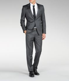 Emporio Armani fashion suit in grey. Wool voile, 1 button, Rear slit, Three pockets, Three internal jacket pockets, Lined interior, Darts, Belt loops, Button, zip fly closure, Four pockets.
