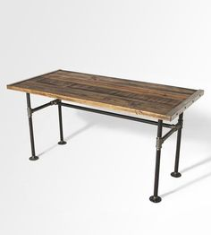 Wood Dining Table with reclaimed wood top and iron pipe legs in