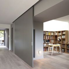 Modern Interior Design At Eco Sustainable House With White Oak Flooring And Grey Sliding Door As Room Divider Hide The Home Library Sliding Room Dividers, Sliding Wall, Wall Dividers, Internal Sliding Doors, Room Divider Doors, Paris Home, Moving Walls, Movable Walls, Interior Barn Doors