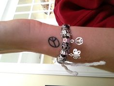 Placement of Peace tattoo ... outside right wrist