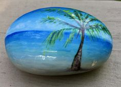 titled: Island Palm Have you own island with a palm tree for shade on a beach on white sand! Measures just over 2 x 3