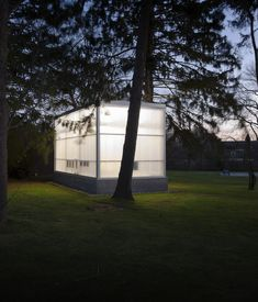 """Completed in 2009, the studio shines in the night among the trees. Weiselberg and Semaan devised a clever foundation system that allowed them to avoid ripping up roots. """"The floor is a concrete slab on a steel deck that sits on a spider web of steel beams,"""" Weiselberg says. So while the floor floats a foot above the ground in the couple's backyard for now, it could one day easily be picked up and moved elsewhere."""