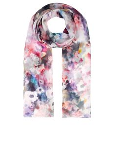 Our beautiful Mia silk scarf is printed with blurred, watercolour-inspired florals in dreamy, ethereal tones.