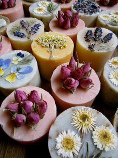 Absolutely gorgeous soaps with dried, pressed flowers and rosebuds.