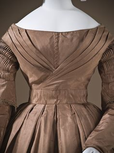 A pleated skirt and bodice and lovely shirred sleeves on a mid-1840s dress. Day dress ca. 1845 From LACMA.