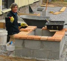 Cinderblock for a wall, firepit, bench, or bar area?  Could spray with concrete stain and top with something attractive.