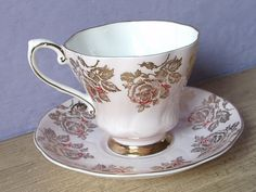 Antique Royal Grafton gold roses Teacup and Saucer