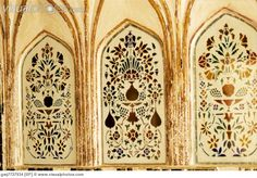 Floral pattern carving on walls of Amber Fort