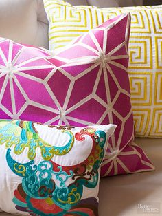 A pop a color in a quirky pattern adds pizzazz to a neutral living room. Vibrant throw pillows, like these bold designs, are an easy way to update a neutral room as your style evolves./