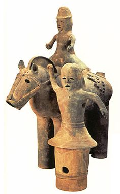 The Kofun period art, Haniwa terracotta clay figure.   A man of power who rode a horse and the person who pull a horse.   The early 500s. Ishikawa Japan.