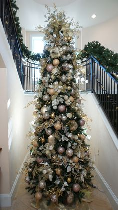 Beautiful gold and blush Christmas tree done at the Broadmoor Hotel in Colorado Springs, CO by Design Works - A Floral Studio in 2014