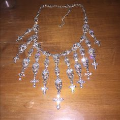 """Crystal skull statement necklace. Brand new crystal embellished skull necklace with crosses. Skull charms are an inch long, and crosses are too. Necklace is 24"""" but can be clasped down to 16 1/2"""". Jewelry Necklaces"""