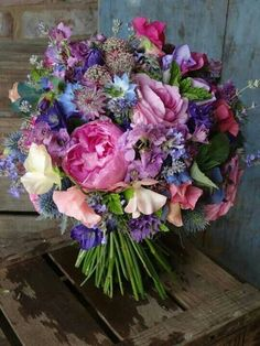 Lovely, Hand Tied Wedding Bouquet Showcasing Blue, Pink, & Purple Fresh Florals, Some Of Which Include: Eryngium Thistle, Roses, Peonies, Sweet Peas, Nigella, Astrantia, ....