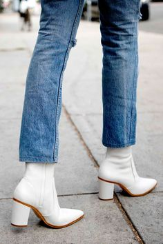 The white boot trend is the latest output in a long line of brave fashion, and unsurprisingly, it's yet another Céline-inspired style. The French house has brought bright white boots into the spotlight for a cool-girl twist on classic ankle styles.