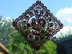 Paper Cut Outs are Typical Lunar New Year Decorations.  This..