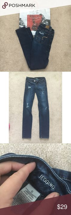 American Eagle distressed dark wash jeggings Size 0. 26 inch waist and 27 inch inseam. No trades! American Eagle Outfitters Jeans Skinny