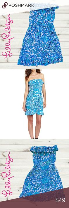 LILLY PULITZER Flor Shorley Blue Sailor Strapless Playful ruffles adorn the breezy silhouette for a sunny fashion forecast ahead. This ruffled strapless mini dress is in the  Shorely Blue Sailor Valentine pattern.  Elasticized waist and top, tulip skirt with ruffle trim, pullover style. Rayon/spandex. Hand wash. Lilly Pulitzer Dresses Strapless