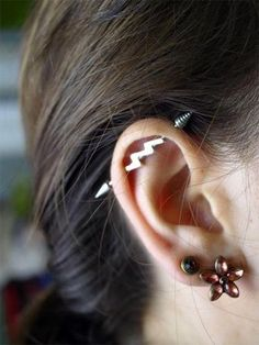 Cute, thunderbolt industrial piercing. on The Fashion Time  http://thefashiontime.com/5-cute-fun-ear-piercing-ideas/#sg23