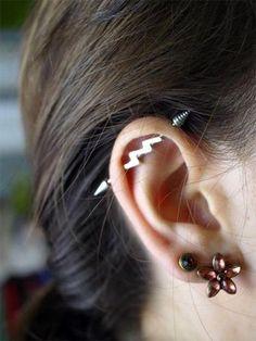 Cute, thunderbolt industrial piercing. on The Fashion Time  http://thefashiontime.com/5-cute-fun-ear-piercing-ideas/#sg23