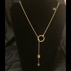 Hammered Gold Circle & Arrow Lariat Necklace Uniquely stunning this hammered gold tone circle & arrow necklace is a statement making piece. 19 inches from the tip of the arrow to bottom of necklace, can be worn a number of ways. Arrow is 1 inch long and circle is 2 inches wide. PLEASE SEE FREE GIFT W/ PURCHASE LISTING  2Chic Jewelry Necklaces