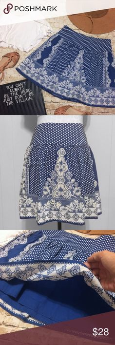 """Urban Outfitters Flowy Skirt Cute and flowy high-waisted skirt by Kimchi Blue for Urban Outfitters. This skirt is fully lined, hits above the knee, has a side zipper making it easy to get in and out of, and boasts a beautiful royal blue and white design which includes polka dots and a bit of floral. The shape is very flattering on! Please note measurements as this skirt could also fit a size 4 comfortable. Waist measures 14"""" across and sits at the natural waist, not hips. Length is 18""""…"""