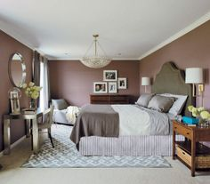 This room is painted Aura Flat Quietly Violet No. CSP-415 by Benjamin Moore