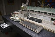 The steam tug M.L.HAMER positions a coal barge along side of Magoun pier. Photo and modeling by Greg Shinnie