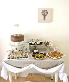 Vintage transportation decor: Old world hot air balloon photo, vintage plane cake topper, map-covered letters/numbers