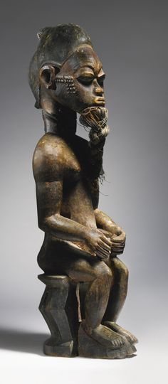 Africa | Seated Male Figure from the Baule people of the Ivory Coast | ca. late 19th to early 20th century
