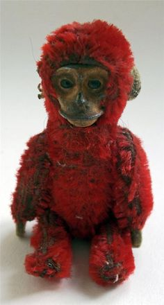Rare Vintage 1930's Schuco Monkey Perfume Bottle Holder  Charming little red mohair monkey from Schuco, pressed tin face with inset glass eyes, felt hands and ear. Head lifts off to reveal tiny glass perfume bottle complete with stopper | Tumblr