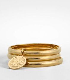 Love these Tory Burch bracelets