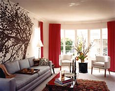 Like the silverish couch and red curtains.  Hint of texture/ pattern print in the carpet and white chairs.
