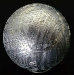 This strange pattern is found only on iron meteorites, and is caused by different bands of alloy called lamellae. The pattern is uncovered when meteorites are cut, polished, and then acid-etched, because one of the alloys is more acid-resistant than the other.   Image: Proteon/Reddit