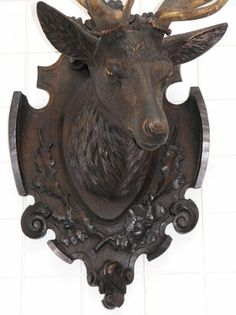 Black Forest Hand Carved Life size Deer Head with glass eyes. Lovely piece. Photo via Ebay.....