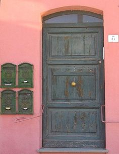 Pink building and green door of Cagliari, Sardegna - Photograph taken by Bonechi Imports