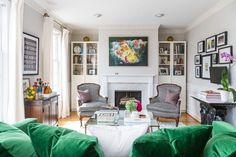 Kerra Michele Huerta's small rental living room in downtown DC -- emerald green velvet sleeper sofa, vintage/antique reupholstered bergere chairs in black and white ikat dot fabric by duralee, vintage bar cabinet/cart, gallery wall around TV, IKEA billy bookcases with wrapping paper in backs -- Apt Envy  See more images from you really CAN love a rental on domino.com See more images from you really CAN love a rental on domino.com