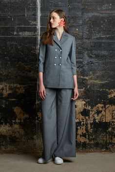 A gray double breasted suit is proof positive of the unerring creativity of Assoulin. It plays with volume, and proportion and doesn't skimp on the details—like bright white buttons. Styled with white sneakers, it seems a nod to Assoulin's friend and supporter Leandra Medine.   - HarpersBAZAAR.com