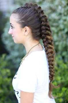 "Dragon Braid | Hairstyles for Girls. Two one-sided Dutch braids, right next to each other, hair parted down middle of head. Pull loops of open braids in the middle to make ""scales,"" and bobby pin open centers together to look like one braid. Video in link. Easy."