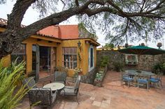 Outdoor garden terrace with stone wall and fountain. #agavesanmiguel #sanmiguelrealestate