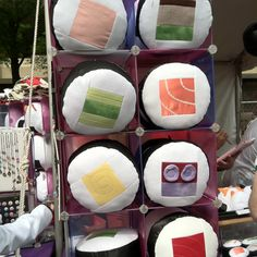 Sushi cushions! Although I'm not sure what the top right and purple circle thing is... I do see tuna and (fatty) salmon and egg, so... bravo! (@ Sakura Matsuri)