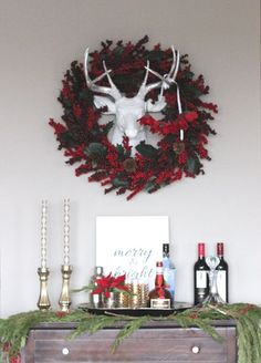 Wreath around my @fauxtaxidermy deer for a festive bar cart