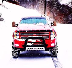 Beautiful New Snow Covered Red Chevy Diesel Duramax... Oh so pretty for the truck of the enemy.... <3 <3 <3