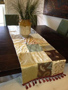 "Check out my ""green"" table runner I made. 100% from re-purposed fabric. Most of the squares are made from upholstery samples swatches."
